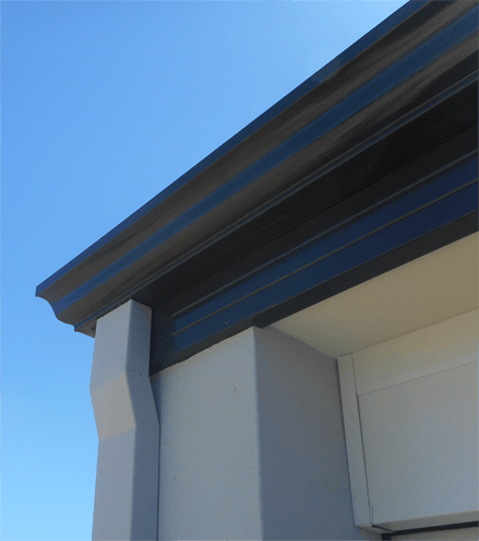 Photo showing downpipe, gutter and fascia on a house
