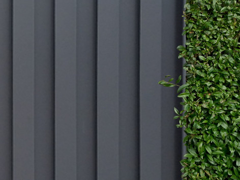 Installed Atlas fence panel with hedge