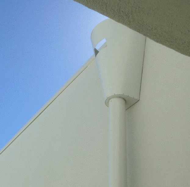 photo of a rain head in situ on a house.