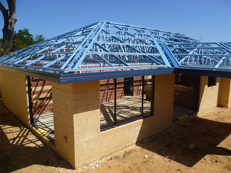 Photo of a house under construction showing steel battens and trusses