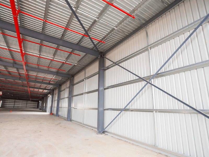 Photo of Trimclad installed as roofing and walling in a large shed.